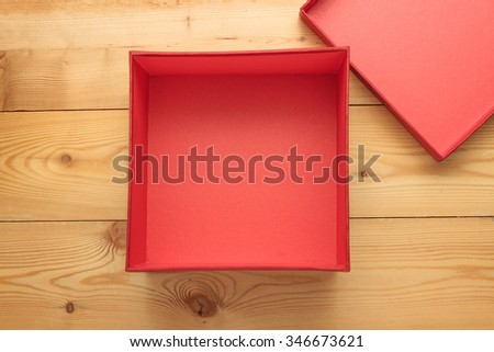 Empty gift box on a wooden background - stock photo