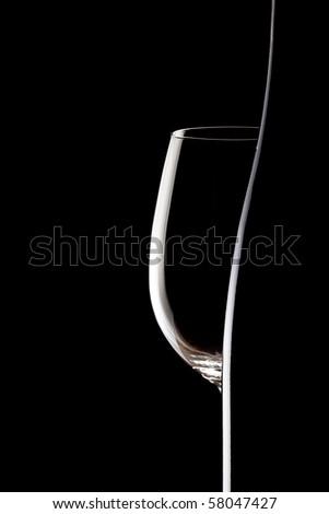 empty glass and winebottle on black background - stock photo