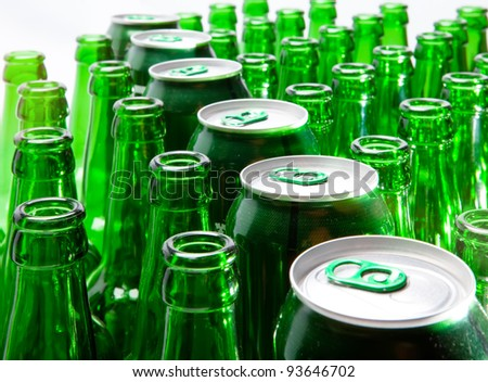 Empty glass beer bottles and cans - stock photo