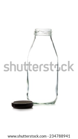 Empty glass bottle of milk with  cap isolated on white background - stock photo