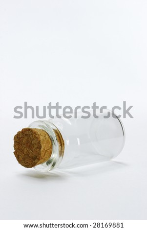 Empty glass bottle on seamless white background with copy space