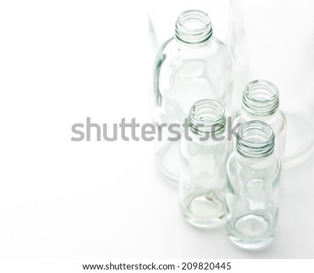 empty glass bottle with copy space selective focus - stock photo