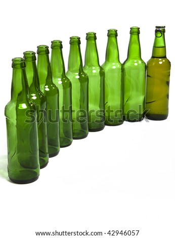Empty glass bottles and one full in end of number