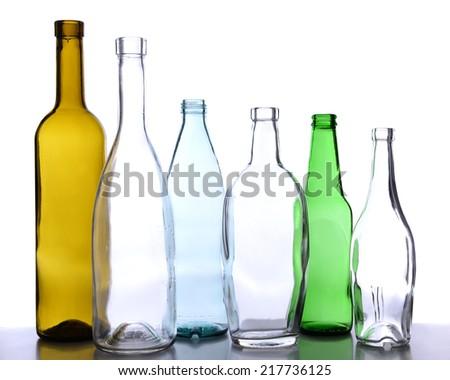 Empty glass bottles isolated on white - stock photo