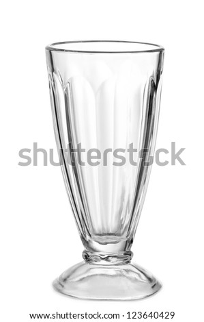 Empty glass for a milkshake on a white background - stock photo