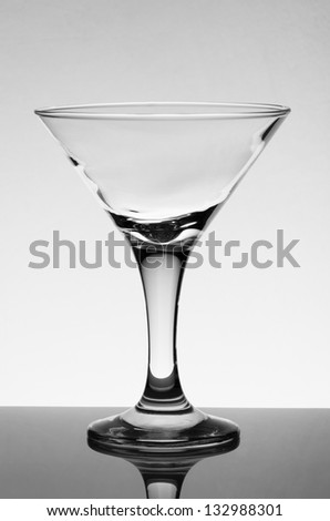 Empty glass for martini with reflection