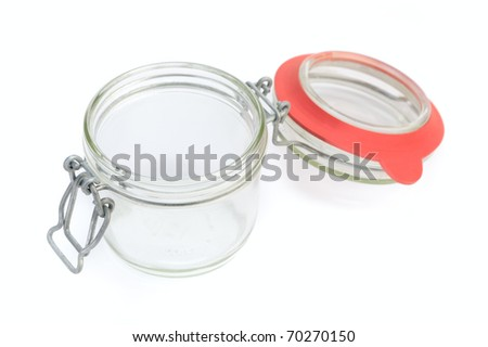 Empty glass jar against white background
