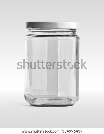 Empty glass jar and white cap in front view isolated on white background. Clipping path.  - stock photo