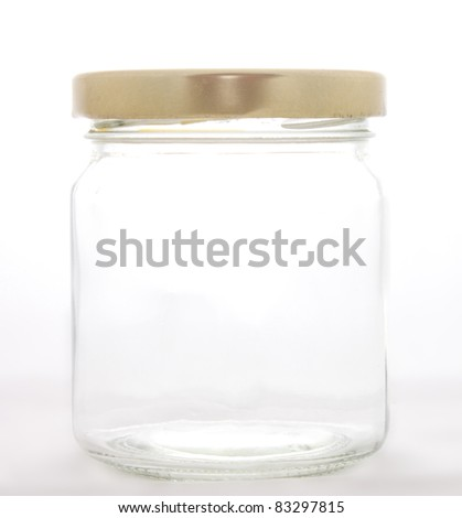 Empty glass jar closed with brass cap