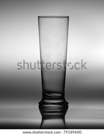 empty glass of beer over grey background - stock photo