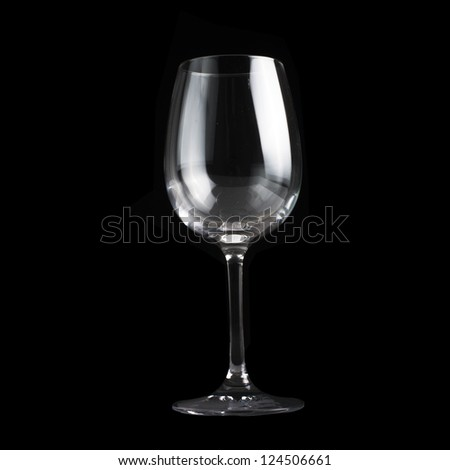 Empty glass of wine on black background