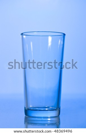 empty glass on blue
