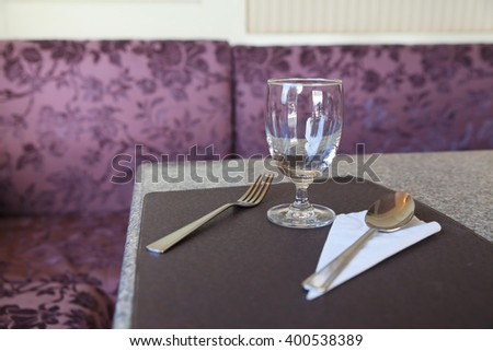 Empty glass on dining table in restaurant. - stock photo