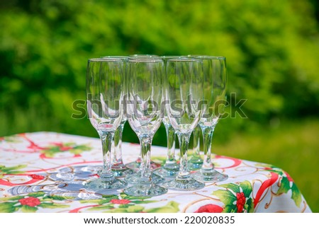 Empty glass on the table on the natural backgound.  - stock photo