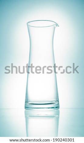 Empty glass pitcher on white background isolated