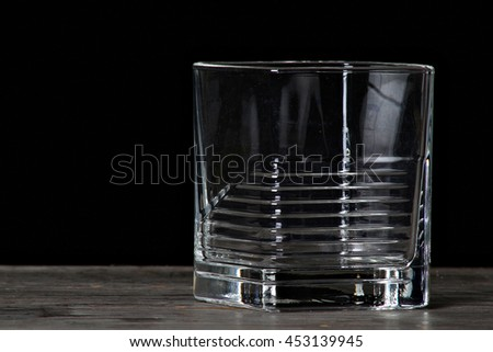 Empty glass shot against a black background. - stock photo