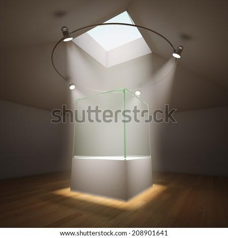 Empty glass showcase in room illuminated by spotlights - stock photo