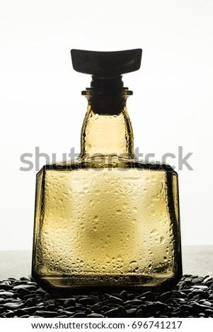 stock-photo-empty-glass-whiskey-bottle-o