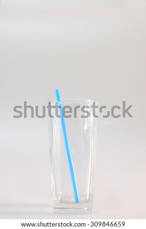 Empty glass with blue tube.