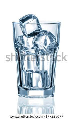 empty glass with ice cubes on white background - stock photo