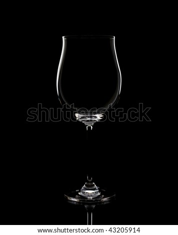 Empty glasses, a dark background - stock photo