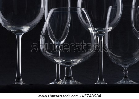 Empty glasses fo wine at black background