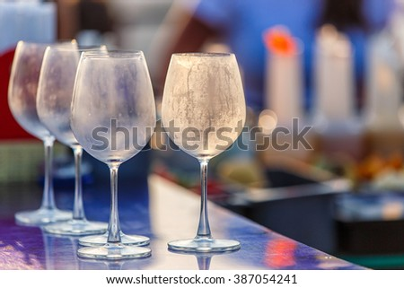 Empty glasses for wine on the table at counter bar from rooftop and restaurant , selective focus - stock photo