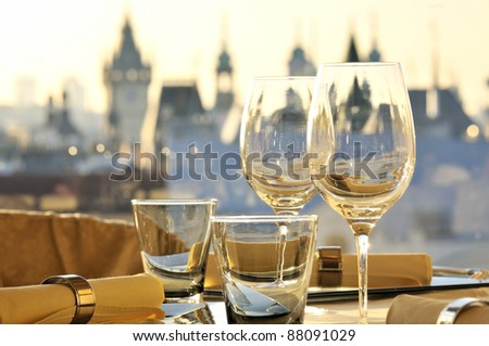 Empty glasses in restaurant Gold Prague - stock photo