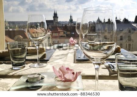 Empty glasses in restaurant Gold Prague - stock photo