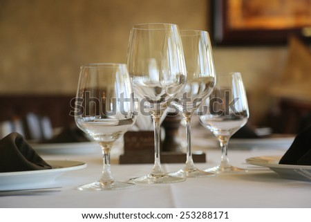 Empty glasses in restaurant on table