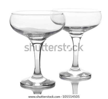 empty glasses of champagne isolated on a white - stock photo