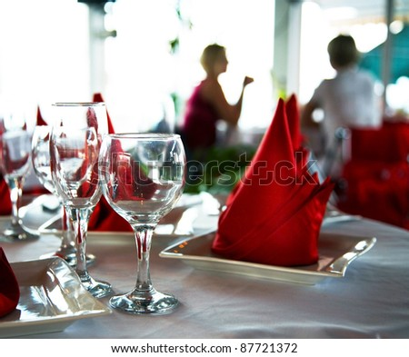 Empty glasses on table in restaurant - stock photo