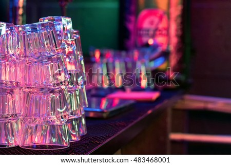Empty glasses on the table. Glasses for a cocktail reflected in the glossy surface of the table.