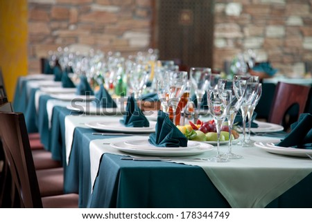 Empty glasses set in restaurant. Banquet table set - stock photo