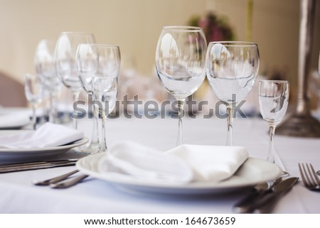 Empty glasses set in restaurant. Part of interior - stock photo