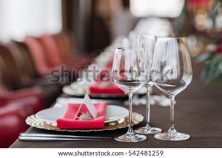 Empty glasses set in restaurant. Part of interior