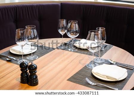 Empty glasses set in restaurant, Setting table in the restaurant - stock photo