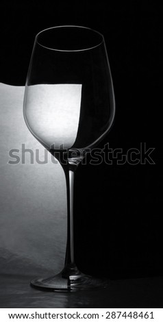 empty goblet on black background - stock photo