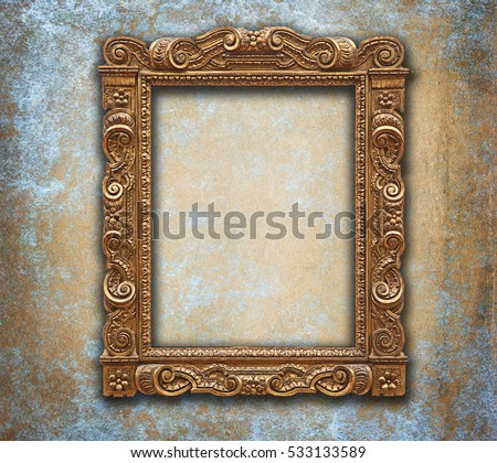 Empty golden baroque frame on grunge blue and orange wall