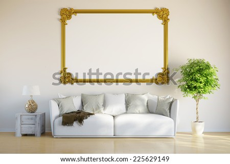 Empty golden frame hanging on wall in living room over a sofa (3D Rendering) - stock photo