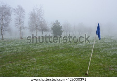 Empty golf course on a cold and foggy day - stock photo