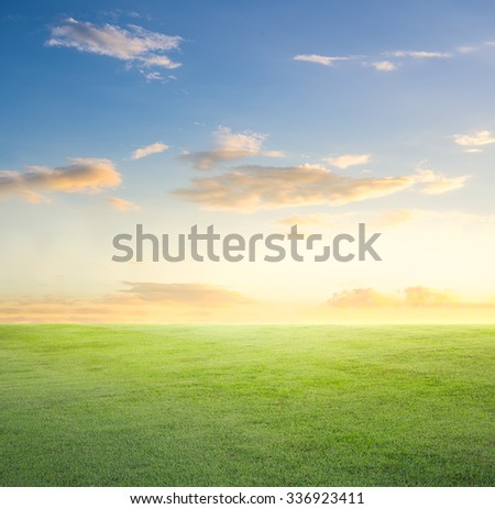 Empty grassland and sky at evening time. - stock photo