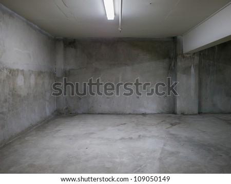 Empty gray concrete room interior. - stock photo