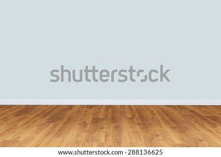 Empty gray wall room with wooden floor - stock photo