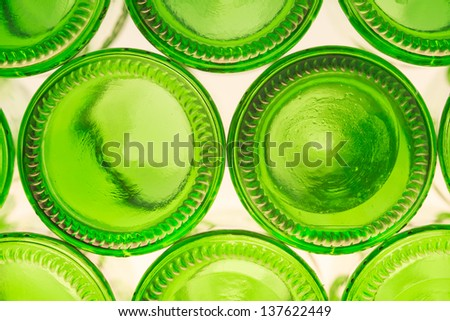 Empty green bottle bottoms, isolated on white background - stock photo
