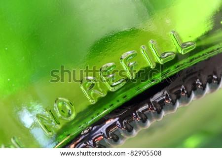 Empty green bottle - no refill - stock photo
