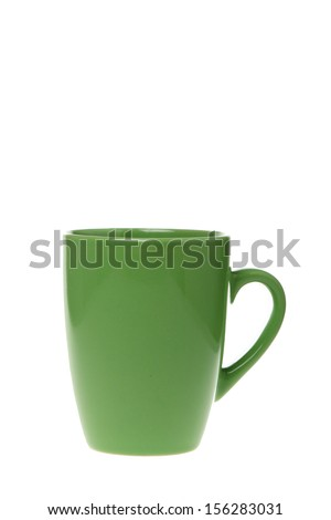 Empty green ceramic tea cup on a white background on Food and Drink