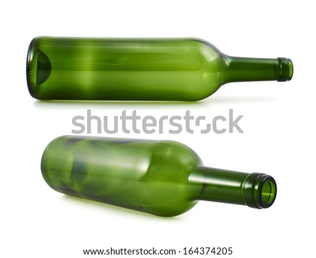 Empty green glass bottle lying on its side, isolated over white background, set of two foreshortenings - stock photo