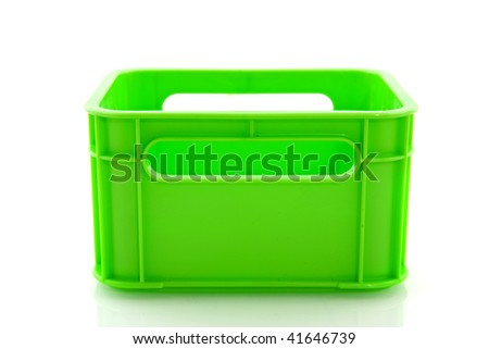 Empty green plastic fluor crate isolated over white