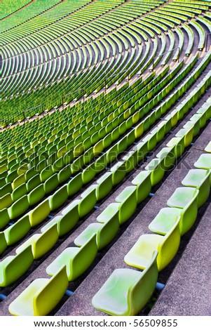 Empty green sports stadium seating. - stock photo